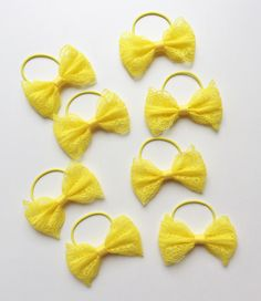 Yellow lace hair bows on thin bobbles - www.dreambows.co.uk #bows #bowsforsale