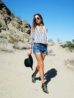 Gala Gonzalez of AmlulWhy adds that cool factor to her look with a skinny scarf, hat, and studded boots.