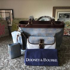 "Rooney & Bourke Blue shoulder Bag 4pc set This beautiful 4pc set in the color of Blue just in time for the season, get in style with this shoulder bag , including the makeup bag, coin purse and keychain, zipper closed measures H10"" W15"" base 4:5"" base has gold metal legs to protect your bag when placing on the any surface come with dust covering bags and registion card , Dooney & Bourke Bags Shoulder Bags"