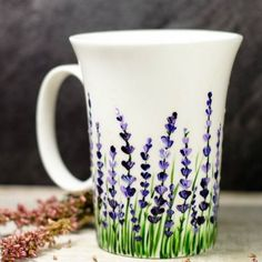 """ceramic painting Do you like the idea of enjoying your morning cup of tea amongst the flowers? If your answer is """"yes"""" be sure to check this amazing hand painted lavender coffee mug. Painted Coffee Mugs, Hand Painted Mugs, Hand Painted Ceramics, Painted Cups, Mugs Sharpie, Diy Mugs, Pottery Painting Designs, Pottery Designs, Mug Designs"""