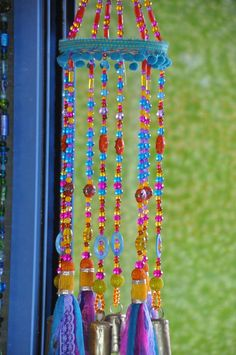 Colorful Sun Catcher Beaded Mobile With Brass #glassbeadstrands #ceilinghanging #bellsdecor #bellwindchimes #windchimes #uniquewindchimes #beadedsuncatcher #glassbeadchimes #glasssuncatchers #glasswindchimes #turquoisemobile #colorfullsuncatcher #colorfulwindchimes Crystal Beads, Glass Beads, Ceiling Hanging, Hanging Mobile, Beaded Curtains, Cozy Living Rooms, Sun Catcher, Bohemian Decor, Christmas Tree Ornaments