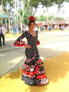 Love this polka dot and floral traditional Spanish feria dress.