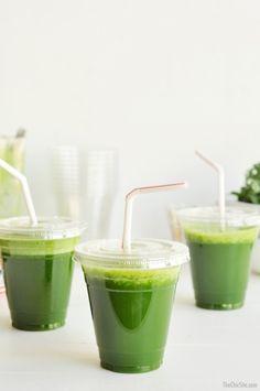 green juice in plastic cups