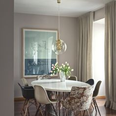the dining chairs feature a different style each. Their shapes, designs, color and texture differs yet together they look like a set.