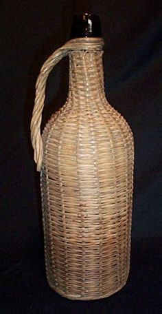 Wicker Covered Brown Glass Bottle