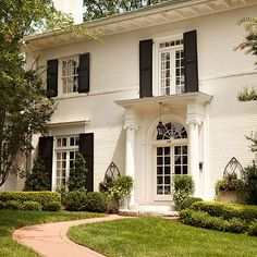 Divided-light windows are a hallmark of traditional architecture! Find more front door ideas here: http://www.bhg.com/home-improvement/door/exterior/traditional-front-doors/?socsrc=bhgpin021715freshtraditional&page=5