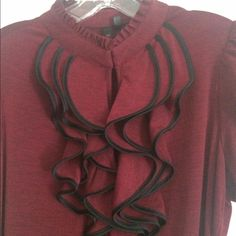 Top Wine colored top great for work. Ruffle in the front with a eye hook closure at the top of the high neck line. Only worn a couple of times. In like new condition. Size XL Tops Blouses