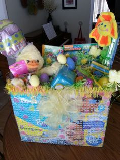 Easter basket for infant easter pinterest easter baskets baby easter basket made on top of diaper box pull the flaps of the box open tape them open in the corner to make a basket place age appropriate items negle Image collections
