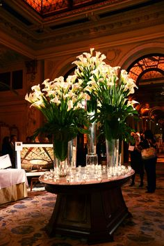 This eye catching design filled with white Calla Lilies accented by glowing candles took the stage at a book signing event. #theplazahotel