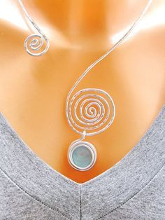 Fashion Necklace, Wrap Necklaces, Spiral Necklace, Asymmetric Necklace, Silver choker Necklace, Bridal Necklace, Adjustable necklace, Wrap Silver Necklaces, Collar Necklace. ♥ Beautiful statement spiral necklace is Lightweight and made from 100% aluminum wire from best quality on the spiral choker hanging Light blue wrapped glass bead pendant and I do it in a very special way, I am giving you one year guarantee. ♥ Beautiful and elegant the statement spiral choker will compliment your…