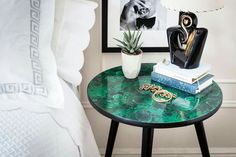 Table makeover using fabric and modpodge to create this interesting malachite side piece.