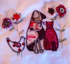 Appliqué cats and dogs for crazy patchwork bag I'm making