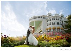 Bride and Groom on Mackinac Island in front of Grand Hotel.  Image by Northern Michigan and Mackinac Island wedding photographers McCoy Made. #GrandHotel #MackinacIslandWedding #RomanticWeddingPictures