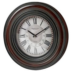 Wall clock with a hand-painted frame.  Product: ClockConstruction Material: Wood and metal Color: Bro...