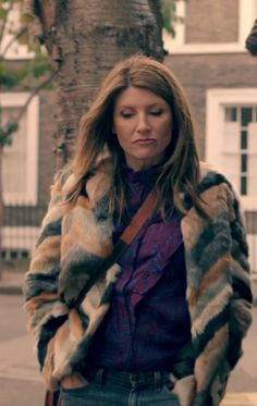 Sharon Horgan on Catastrophe: Season 3, episode 3. Patchwork chevron fur coat, purple and blue blouse, jeans, grey booties, cross body bag