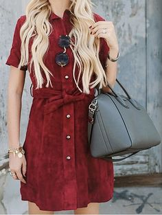 A red suede dress and grey purse