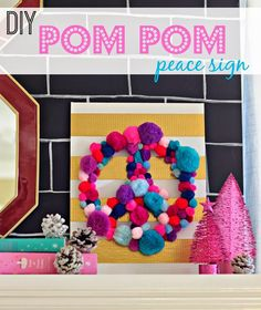diy pom pom peace sign  This would be so cute as an initial or something for Rosie's room! Love the Pom poms!!