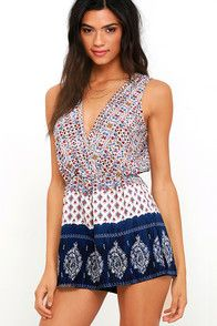 Wherever the wind carries you, you can count on feeling fine and free in the Hills and Valleys Navy Blue Print Romper! Light and dreamy woven fabric has a beige, navy blue, red, and yellow print. Sleeveless, surplice bodice, with tying back, leads into an elasticized waist and fluttering shorts. #CuteDresses #TrendyTops, #FashionShoes #JuniorsClothing