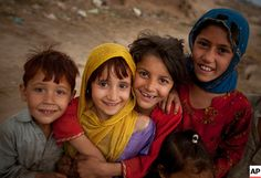 Pakistani and Afghan #refugee children smiles to the camera on outskirts of Islamabad, #Pakistan, Friday, May 7, 2010.