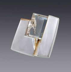 Eleanor Moty - Crystal Cavern Brooch : 2013 Sterling silver, 18K gold, quartz with phantom crystal Tom Munsteiner, lapidary artist, Idar Oberstein, Germany