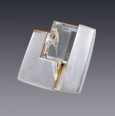 Eleanor Moty - Crystal Cavern Brooch : 2013 Sterling silver, 18K gold, quartz with phantom crystal Tom Munsteiner, lapidary artist, Idar Oberstein, Germany