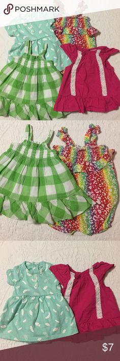 4 Bundle of Dresses & Rompers Super cute! Good condition. Bundle consists of 4 spring or summer outfits, sizes 0-3 months.             Rainbow romper is newborn size but runs big, more like 3 months. Teal Onesie dress with feather print is newborn. Green and white checker dress is 3 months. Hot pink dress is 3 months. Dresses Casual