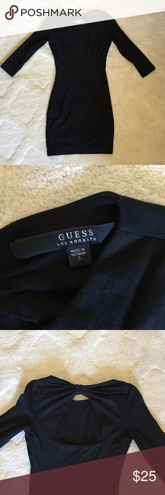 GUESS BLACK BODYCON DRESS The perfect LBD for any occasion! Thick yet stretchy material with an open back. Looks great with a statement necklace. Size Small. Guess Dresses Mini