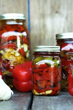Fire Roasted Red Peppers Preserved in Olive Oil: delectable fire roasted peppers to add to everything from pizza to pasta to salad to pimiento cheese to sandwiches through the cold months.roasted red pepper, smoked bleu cheese and garlic stuffed kalamata Roasted Red Pepper Pasta, Roasted Red Peppers, Grilled Peppers, Canning Food Preservation, Preserving Food, Pickles, Garlic Olive Oil, Canning Recipes, Salad Recipes