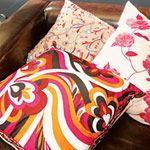 Vintage scarf cushions. I want to hit the thrift stores in search of cool scarves to make new throw pillows for my couch.