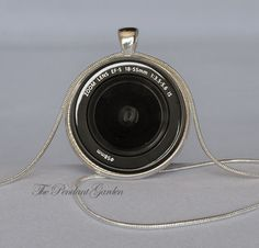 CAMERA PENDANT Camera Lens Pendant Black White Photography Jewelry Photography Necklace Camera Pendant Photographers Gift Camera Necklace. $10.95, via Etsy.
