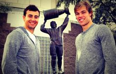 Jordan Eberle and Taylor Hall, Edmonton Oilers with the statue of Wayne Gretzsky behind them. Check it out when you go to Edmonton