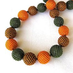 Items similar to Oranges, Olives and Caramel Beaded Balls Necklace on Etsy Chunky Jewelry, Beaded Jewelry, Beaded Necklace, Beaded Bracelets, Necklaces, Crochet Ball, Bead Crochet, Ball Necklace, Beading Techniques