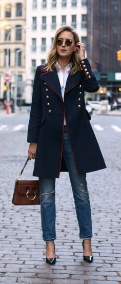 navy military coat with red piping and brass double-breasted buttons, classic white button down shirt, ripped straight-leg boyfriend jeans, patent leather pointy toe navy pumps, medium brown leather pierce bag, round sunglasses, gold chokers {Mango, Levi's, Theory, J.W. Anderson, Jimmy Choo, Baublebar}