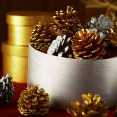 Inexpensive Christmas Decorating Ideas For 2009 - Part Two: Turn to Mother Nature for Decorating Help — Style Estate Pine Cone Decorations, Christmas Table Decorations, Holiday Fun, Christmas Time, Christmas Projects, Holiday Ideas, Christmas Ideas, Painted Pinecones, Christmas Baskets