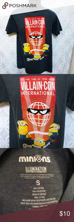 """Minions Villain-Con International Despicable Me Minions Villain-Con International Despicable Me Tee NWOT.     Measurements Laying Flat Size 🔹S Armpit to Armpit 🔹19"""" Shoulder to Hem 🔹31"""" Bundle to Save 🤓 Sorry NO outside transactions 🚫 NO trades 🚫 Reasonable Offers welcomed 👍 NO Low balling 👎 NO modeling 👎 NO Holds👎 All items from a pet 😼and Smoke Free Home  Happy Poshing 🤗 Minion Made Shirts Tees - Short Sleeve"""