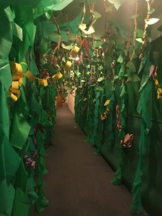 Our completed hallway for Journey off the map- We used inexperienced plastic tablecloths, tissue paper flowers, and home made jungle vines. Safari Party, Safari Theme, Jungle Safari, Preschool Jungle, Jungle Crafts, Paper Leaves, Tissue Paper Flowers, Jungle Theme Decorations, Just Kids