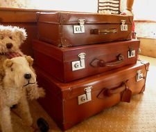 Vintage suitcases make for great storage in any room in the house .......