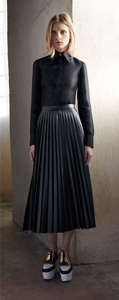 All black fall uniform: Leather pleated skirts and black silk button-down at Céline