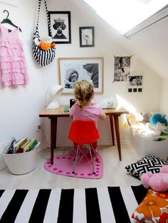 Great use of a small color range - black, pink and white to make a awesome graphic girl's room!