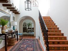 In the entry of a 1930s Spanish Colonial home in the flats of Beverly Hills…