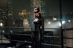CATWOMAN This feline fatale elevated cat-burgling to a super-sexy art in her snug black cat suit and kitty ears. There's more than a dollop of the sadomasochistic in her mask, whip, and thigh-high boots, which is perhaps what has long kept rich boy Batman clawing for more.