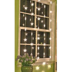 Star garlands over small windows with plain curtains and star painted curtains over large window??