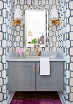 Bathroom Decorating Ideas. Powder Room with floating vanity and geometric wallpaper by Jennifer Barron Interiors.
