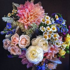 Another angle of Lauren's bridal bouquet. Be sure to follow @theflowermaven and @breckweddings on IG for more fun flowery weddings and mountain action. #breckweddings  petalandbean.com breckweddings.com  instagram.com/theflowermaven instagram.com/breckweddings
