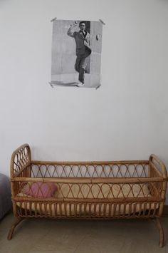 i love the cheeky photo above the crib  #FeatherYourNest