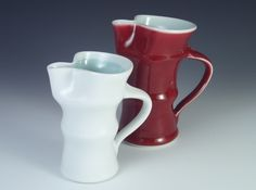Porcelain jugs glazed in Celadon and Peach Bloom Red glazes by Matthew Blakely.