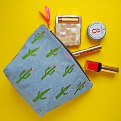 This cactus make up pouch is a fun, eye catching, embroidered make up bag to help contain all your day to day glamour!  Based on original drawings and embroidered and handmade by me, this fully lined, zipped bag is perfect for all the bits and pieces that normally roll around inside your handbag (or at least mine anyway, and I carry at least 3 red lipsticks with me at all times!)  Each make up bag can have yours or someone specials initials embroidered on one side, or a message inside…