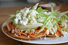 Tostadas de Tinga are delicious and easy to make. Give them a try for a unique twist on a popular Mexican food!These Tostadas de Tinga are delicious and easy to make. Give them a try for a unique twist on a popular Mexican food! Authentic Mexican Recipes, Popular Mexican Food, Mexican Food Recipes, Mexican Desserts, Dinner Recipes, Drink Recipes, Mexican Tostadas, Ceviche Mexican, Mexican Crema