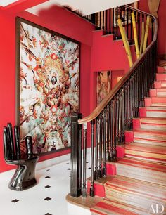 A Caio Reisewitz C-print and a Pedro Friedeberg hand chair share the entrance hall | archdigest.com