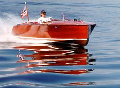 Buys and sells mahogany boats and rebuilt Chris Craft engines. Includes product details, classifieds, and an insurance quote form. Located in Spring Park, Minnesota.